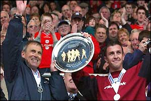 Crewe boss Dario Gradi (left) picks up the Division Two runners-up trophy