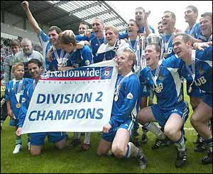 Wigan players celebrate the Divison Two championship