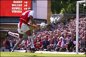 Thierry Henry coolly nods home the rebound from Parlour's shot