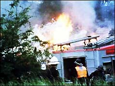 The wrecked Trident jet bursts into flames at the crash scene
