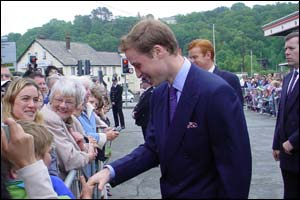 Prince William talking to members of the public outside Bangor station