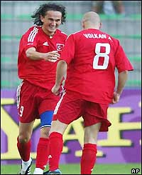 Sanli Tuncay and Volkan Arslan celebrate the winning goal