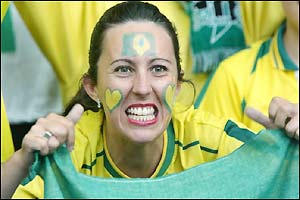 Brazil fans gear up for the match in their traditional colourful attire