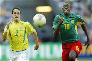 Mohamadou Idrissou (right) chases down the ball with Brazil defender Belletti