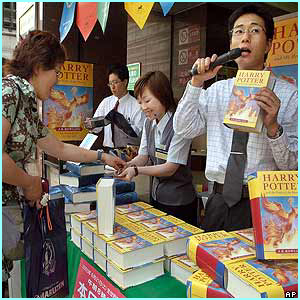 Japan: A salesman calls on the public to buy their copies from his Tokyo street store
