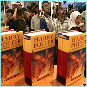 Malaysia: Fans in Kuala Lumpur see the book through the window of a shop as they queue up
