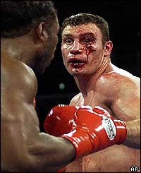 With Klitschko's face badly cut the referee stops the fight
