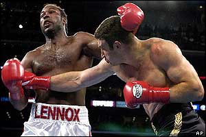 Klitschko staggers Lewis as the fighters trade heavy blows