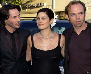 Keanu Reeves, left, Carrie-Anne Moss and Hugo Weaving