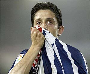 Real Sociedad's Nihat kisses his shirt after scoring a goal against Atletico de Madrid