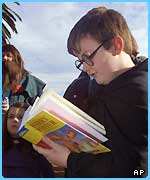 A young Australian fan gets stuck into his copy