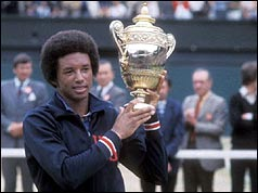 Arthur Ashe with the Wimbledon Trophy