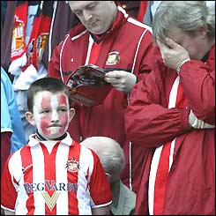 Sunderland fans looks despondent before their team's final game in the Premiership