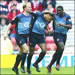 Dennis Bergkamp congratulates Thierry Henry on scoring the first goal for Arsenal