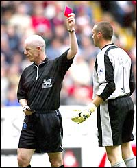 Referee Dermot Gallagher shows Charlton keeper Dean Kiely the red card after a clash with Louis Saha