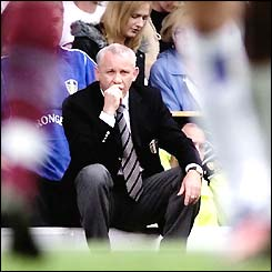 Peter Reid watches his Leeds team in action