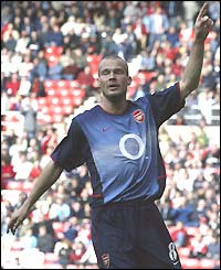 Freddie Ljungberg celebrates scoring for Arsenal in their 4-0 win