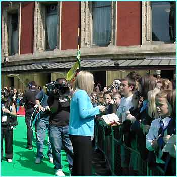 Who's this signing autographs in the sun outside the Albert Hall? She looks vaguely familiar...