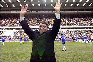 Graham Taylor waves to the fans on his return to management with Aston Villa