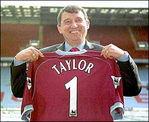 Graham Taylor holds aloft a Aston Villa shirt after taking over as manager for a second time