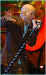 Michael Stipe sings as REM headline on the first night