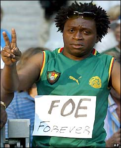 A Cameroon fan pays his respects to Foe at the stadium