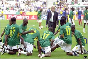 The Cameroon team warm-up wearing Foe shirts before the final