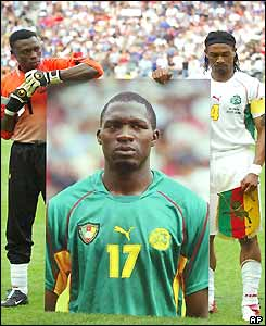 Cameroon goalkeeper Idris Kameni and captain Rigobert Song hold a picture of Foe during Cameroon national anthem