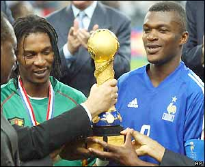 Marcel Desailly and Rigobert Song accept the Confederations Cup