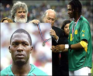 Sepp Blatter hangs a runner-up medal on the picture of Marc-Vivien Foe