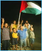 Palestinian children celebrate the departure of the Israeli troops