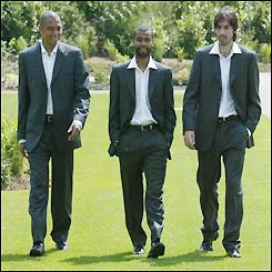 Gilberto Silva, Ashley Cole and Robert Pires show off Arsenal's 2003 FA Cup final suit