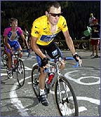 Lance Armstrong tearing up a steep climb