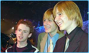Chris Rankin with some of his Weasley co-stars