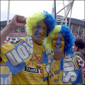 Two fans appear in good spirits ahead of the match