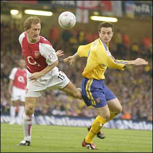 Arsenal's Ray Parlour and Southampton's Matt Oakley challenge for the ball