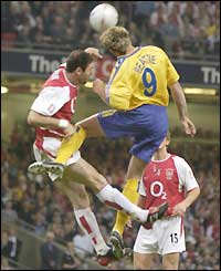 Arsenal defender Martin Keown in an aerial challenge with Saints striker James Beattie