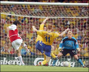 Arsenal's Robert Pires scores the first goal of the game
