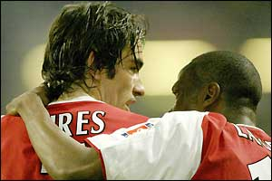 Arsenal's Robert Pires is congratulated by team-mate Lauren