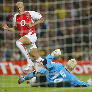 Thierry Henry's shot is saved by Antti Niemi