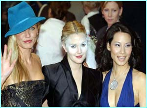 It's Charlie's Angels - Cameron Diaz, Drew Barrymore and Lucy Liu. Check out Drew's make-up!