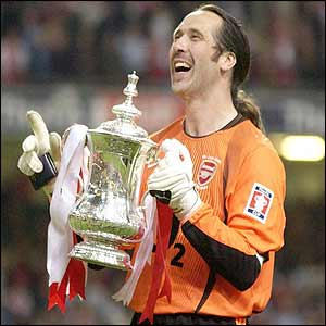 Arsenal's stand-in captain David Seaman lifts the FA Cup