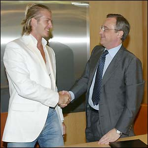 David Beckham shakes hands with Real Madrid president Florentino Perez