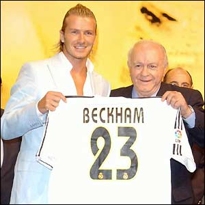 David Beckham is presented with his Real Madrid shirt by club legend Alfredo di Stefano