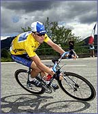 Lance Armstrong descends a mountain in the Tour de France