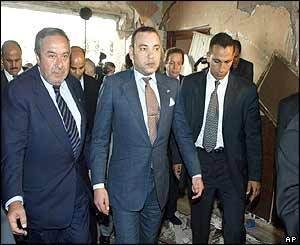King Mohammed VI (centre) tours bomb site