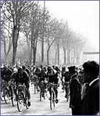 Riders do laps of the Champs Elysees in Paris in the very first Tour de France