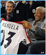 Becks gave Mandela a personalised England shirt