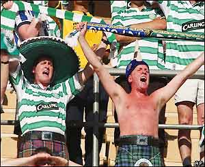 The Celtic fans sing in the stadium