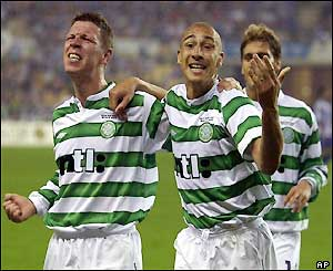 Larsson and Alan Thompson (left) celebrate the equalising goal